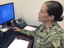 U.S. Navy Legalman First Class Tamatha Schulmerich works at her desk at the Naval War College.