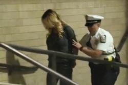 Porn actress Stormy Daniels is led into jail in Columbus, Ohio., after being taken into custody during a Wednesday evening, July 11, 2018, show.