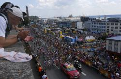 Spectators watch the start of the sixth stage of the Tour de France cycling race over 181 kilometers (112.5 miles) with start in Brest and finish in Mur-de-Bretagne Guerledan, France.