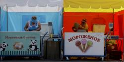 Two ice cream sellers prepare for business at their stand during the 2018 soccer World Cup in Nizhny Novgorod, Russia.