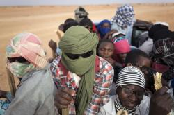 In this Monday, June 4, 2018 file photo, Nigeriens and third-country migrants head towards Libya from Agadez, Niger