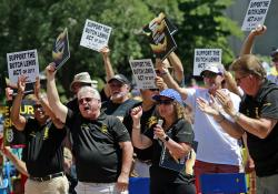People cheer while appearing in support of pensions during a rally at the Ohio Statehouse in Columbus, Ohio, Thursday, July 12, 2018