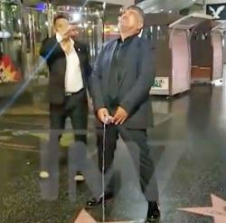 George Lopez fakes urinating on Donald Trump's Hollywood Walk of Fame star on Tuesday, July 10, 2018.