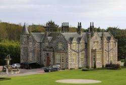 In this file photo dated Friday Oct. 6, 2017, a view of MacLeod House, a sixteen room boutique hotel, at the Trump International golf course in Balmedie, Scotland.