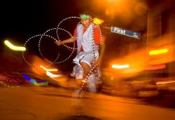 A hoop dancer wows the crowd in downtown Gallup, N.M. as part of the Gallup Inter-Tribal Indian Ceremonial night parade.