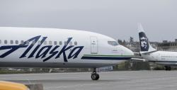 An Alaska Airlines plane taxis Friday, April 13, 2018, at the Seattle-Tacoma International Airport in Seattle.