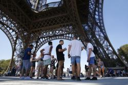Tourists at the Eiffel Tower.