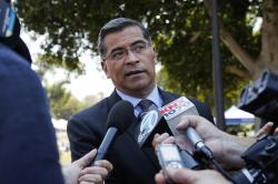 California Attorney General Xavier Becerra talks to reporters after a news conference at University of California, Los Angeles Thursday, Aug. 2, 2018