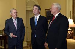In this July 10, 2018, file photo, Senate Majority Leader Mitch McConnell of Ky., left, speaks as he talks about Supreme Court nominee Brett Kavanaugh, center, as Vice President Mike Pence, right, listens, during a visit Capitol Hill in Washington