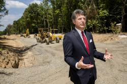 In this July 25, 2018, photo, Stephen Bell, president and CEO of the Arkadelphia Area Chamber of Commerce, talks about a new railroad spur that is being built to support the needs of what he hopes will be a new paper mill, one of several Chinese-backed deals Arkansas has landed in recent years, in Arkadelphia, Ark.