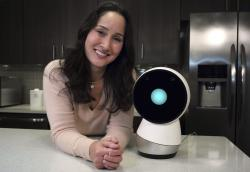 In this Nov. 21, 2017, photo Massachusetts Institute of Technology robotics researcher Cynthia Breazeal, left, stands next to social robot Jibo, right, at the company's headquarters in Boston