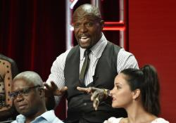 "Terry Crews, center, a cast member in the NBC Universal television series ""Brooklyn Nine-Nine,"" answers a questino as cast members Andre Braugher, left, and Melissa Fumero look on during the 2018 Television Critics Association Summer Press Tour."