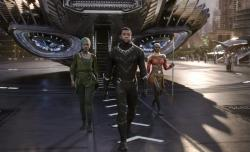 "Lupita Nyong'o, left, and Chadwick Boseman and Danai Gurira in a scene from Marvel Studios' ""Black Panther."""