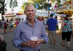 Michael Avenatti, the lawyer representing adult film actress Stormy Daniels, drinks a beer at the Iowa State Fair in Des Moines, Iowa.