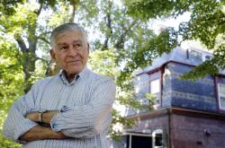 In this Thursday, Aug. 2, 2018 photo former Massachusetts governor and onetime Democratic presidential candidate Michael Dukakis stands for a photograph at his home, in Brookline, Mass.
