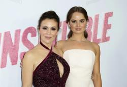 "Alyssa Milano, left, and Debby Ryan arrive at the LA Premiere of ""Insatiable."""