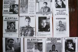 In this July 24, 2018 photo, flyers of missing persons cover a wall inside the Nicaraguan Center for Human Rights, in Managua, Nicaragua
