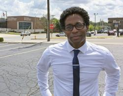 In this Aug. 8, 2018 photo, Wesley Bell stands outside the Ferguson, Mo., police headquarters.