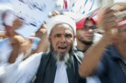 A man shouts during a demonstration in Tunis, Saturday Aug 11, 2018. Thousands of Muslim fundamentalists have held an hours-long protest in front of the nation's parliament to decry proposals in a government report on gender equality.