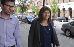 Christine Hallquist, transgender candidate seeking the Democratic party nomination to run for governor of Vermont, walks with campaign aide David Glidden in Burlington, Vt.