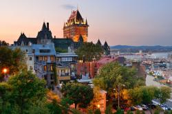 Quebec City skyline with Chateau Frontenac at sunset.