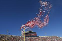 In this Oct. 14, 2017, file photo balloons are released in Memorial Stadium before an NCAA college football game between Indiana and Michigan in Bloomington, Ind.