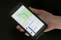 In this Aug. 8, 2018, file photo a mobile phone displays a user's travels using Google Maps in New York.