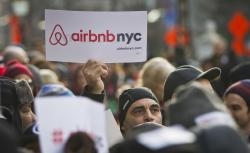 In this Jan. 20, 2015, file photo, supporters of Airbnb hold a rally outside City Hall in New York