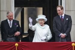 In this June 5, 2012 file photo, Queen Elizabeth II, center, accompanied by Prince Charles, left, and Prince William, appear on the balcony of Buckingham Palace in central London, to conclude the four-day Diamond Jubilee celebrations to mark the 60th anniversary of the Queen's accession to the throne