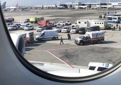 Emergency response crews gather outside a plane at New York's Kennedy Airport.