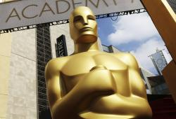 An Oscar statue appears outside the Dolby Theatre for the 87th Academy Awards in Los Angeles.