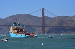 A ship tows The Ocean Cleanup's first buoyant trash-collecting device toward the Golden Gate Bridge in San Francisco en route to the Pacific Ocean on Saturday, Sept. 8, 2018