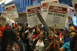 Hotel workers picket in front of the Palmer House hotel in the Chicago Loop.