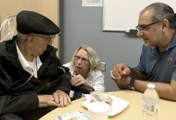 The Rev. John Sabbagh, left, and his son Ebby Sabbagh talk with nurse practitioner Kim O'Riley, Friday, Sept. 7, 2018 in Gilbert, Ariz.