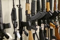 This March 1, 2018 file photo shows a display of various models of semi-automatic rifles at a store in Pennsylvania