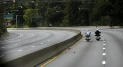 In this Sept. 26, 2015, file photo Philadelphia motorcycle police ride down a closed Schuylkill Expressway in Philadelphia