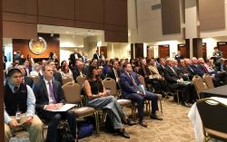 Prize winners and other observers look on Wednesday, Sept. 12, 2018, in Columbus, Ohio, as another $2.4 million is awarded through the Ohio Opioid Technology Challenge