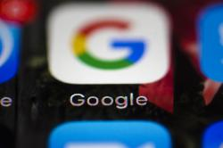 This April 26, 2017, file photo shows a Google icon on a mobile phone in Philadelphia