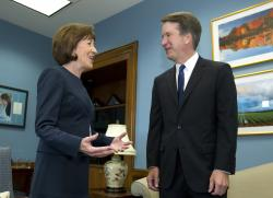 In this Tuesday, Aug. 21, 2018, file photo, Sen. Susan Collins, R-Maine, speaks with Supreme Court nominee Judge Brett Kavanaugh at her office, before a private meeting on Capitol Hill in Washington