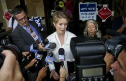 New York gubernatorial candidate Cynthia Nixon, center, speaks to members of the media outside a polling station after voting in the primary in New York.