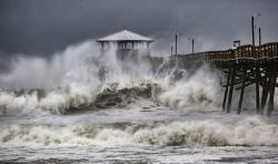 Waves slam the Oceana Pier & Pier House Restaurant in Atlantic Beach, N.C., Thursday, Sept. 13, 2018 as Hurricane Florence approaches the area
