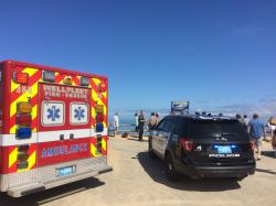 Emergency personnel respond to Newcomb Hollow Beach in Wellfleet, Mass, on Saturday, Sept. 15, 2018