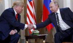 In this file photo taken on Monday, July 16, 2018, U.S. President Donald Trump, left, and Russian President Vladimir Putin, right, shake hand at the beginning of a meeting at the Presidential Palace in Helsinki, Finland