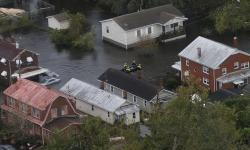 Rescue personnel use a small boat as they go house to house checking for flood victims from Florence in New Bern, NC., Saturday, Sept. 15, 2018