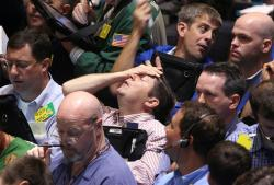 In this Sept. 16, 2008, file photo traders work in the product options pit at the New York Mercantile Exchange in New York