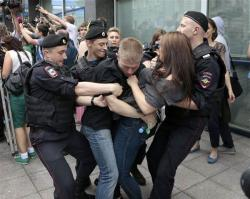 Police officers detain gay rights activists as they gathered near the State Duma, Russia's lower parliament chamber, in Moscow, Russia, on June 11, 2013.