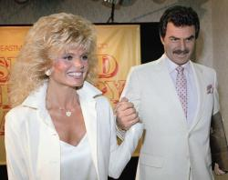 In this March 27, 1987 file photo, Burt Reynolds, right, holds hands with Loni Anderson at luncheon in Los Angeles.