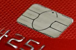 This June 10, 2015, file photo shows a chip credit card in Philadelphia
