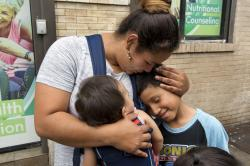 In this Friday, Aug. 3, 2018 file photo, Honduran Eilyn Carbajal hugs her then-8-year-old son Nahun Eduardo Puerto Pineda, right, after they were reunited at the Cayuga Center, in New York.