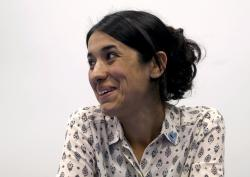 In this Monday, May 22, 2017 file photo, Human rights activist Nadia Murad speaks during an interview with The Associated Press at the International Center in Vienna, Austria